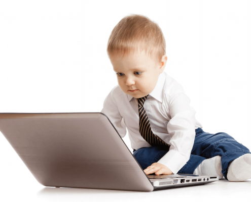 toddler working on a laptop
