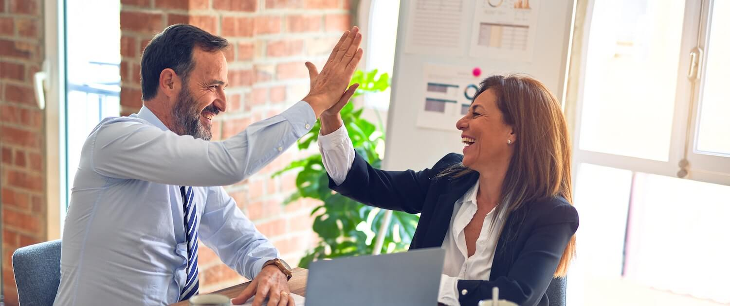 business owners doing a high five due to Find Net Solutions effective website site solutions