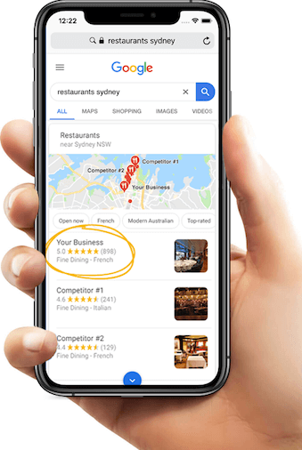 Google reviews on a mobile phone held in a hand